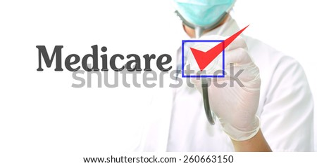 doctor with a stethoscope with the word Medicare written in it - stock photo