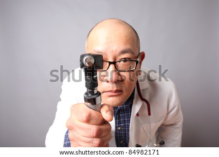 Doctor with an otoscope.