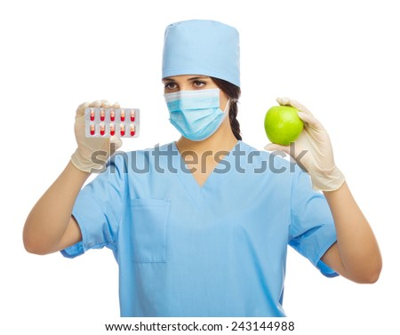 Doctor with apple and pills isolated - stock photo