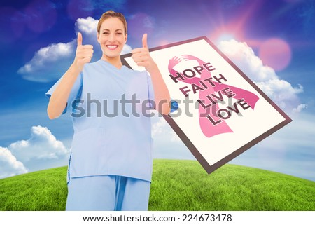 Doctor with breast cancer awareness message for awareness month - stock photo