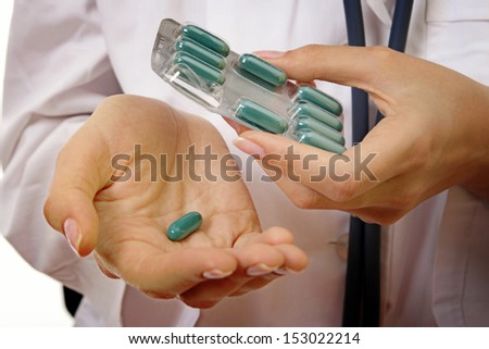 Doctor with drugs in her hands. - stock photo
