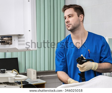 Doctor with endoscope. - stock photo