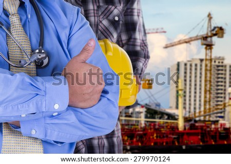doctor with engineering in construction site - stock photo