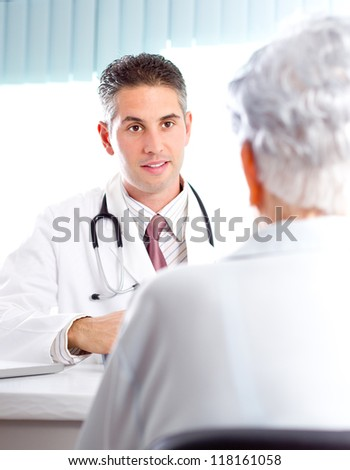 Doctor with female patient discussing treatment. - stock photo