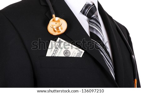 doctor with gold stethoscope and money in a business suit ( money in pocket ) isolated on white background - stock photo