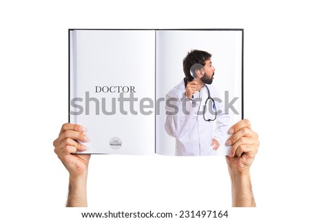 Doctor with magnifying glass - stock photo