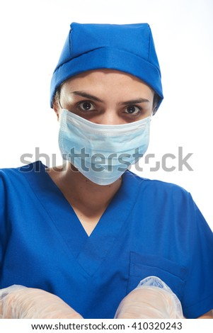 doctor with mask on blue uniform and white background