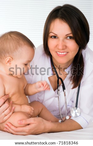 doctor with newborn on a white background - stock photo