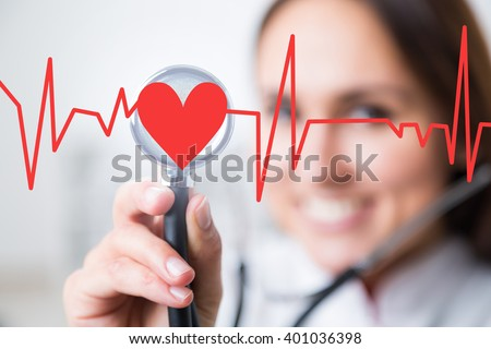 Doctor with phonendoscope at background, heart and cardiogram in front. Concept of medical help. - stock photo