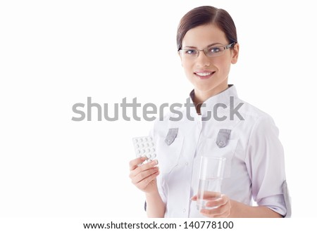 Doctor with pills on a white background