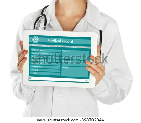Doctor with stethoscope and digital tablet, isolated on white - stock photo