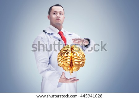 Doctor with stethoscope and golden brains on the hands. gray background. High resolution.