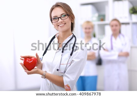 Doctor with stethoscope holding heart, isolated on white  background