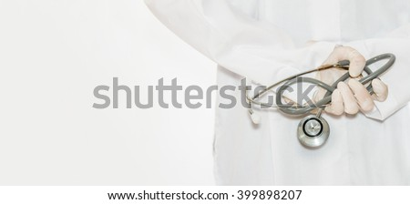 Doctor with stethoscope holding in hands, copy space.