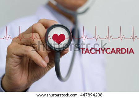 Doctor with stethoscope in hand and EKG (electrocardiogram) graph monitor diagnosis cardiac tachycardia, heart disease, health and medical concept. - stock photo