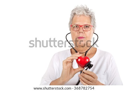 Doctor with the stethoscope with heart on white background - stock photo