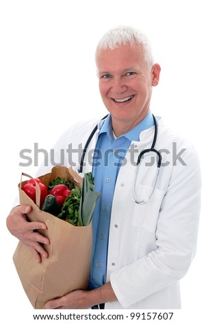 Doctor with vegetables in a shopping bag