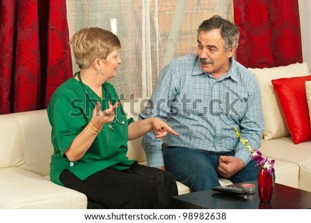 Doctor woman and senior man having conversation home