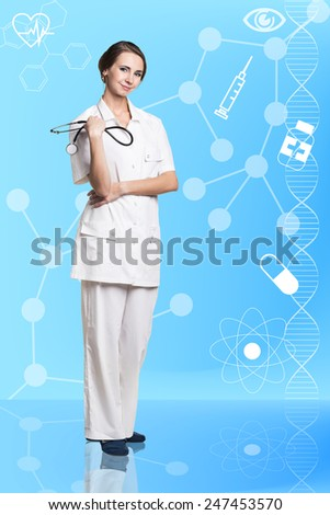 Doctor woman crossed her arms over her chest, one hand holding a stethoscope - stock photo