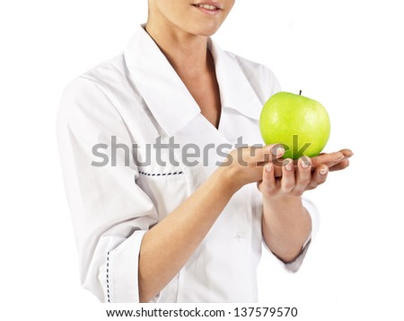 Doctor (woman) holding green apple isolated on white background