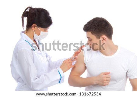 Doctor woman in mask give flu vaccination or insulin injection shot to a patient isolated on white background - stock photo