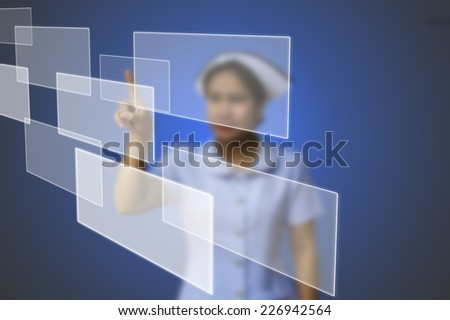 doctor woman use innovative technologies and touch empty touchscreen with empty button copy space in the air  - stock photo