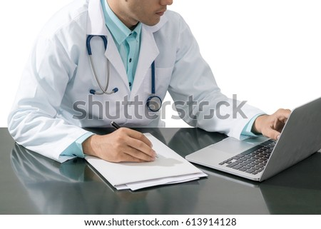 Doctor working on desk with laptop computer and paperwork Isolated on white background. Medical concept.