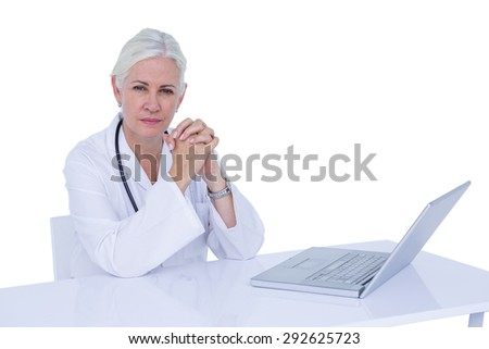 Doctor working on her laptop and calling on a white screen