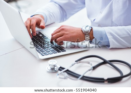 Doctor working on the computer