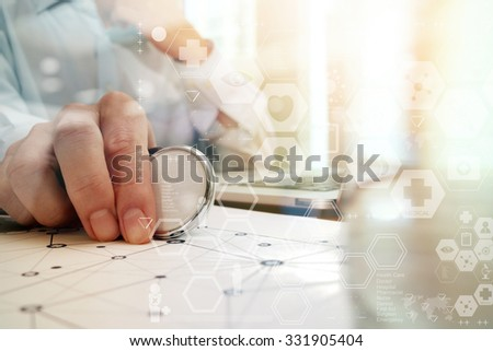 doctor working with laptop computer in medical workspace office and medical digital network media diagram as concept - stock photo