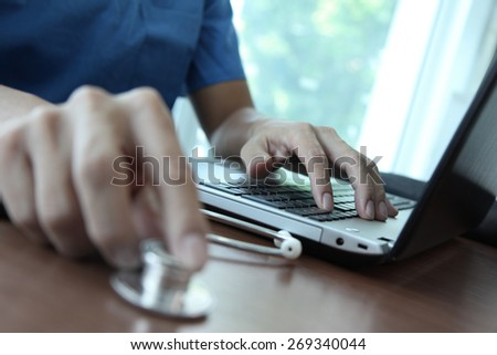 Doctor working with laptop computer in medical workspace office as concept - stock photo