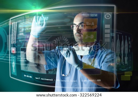 Doctor working with modern screens in a lab - stock photo