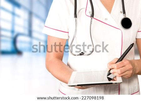 doctor working with the tablet - stock photo