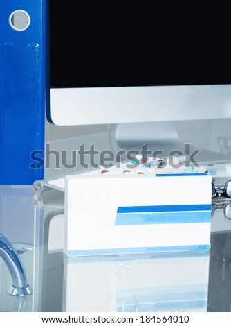Doctor workplace. Pills, tablets, box - stock photo