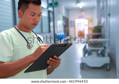Doctor writing a medical prescription in hospital