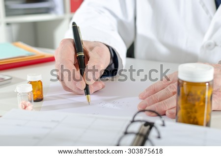 Doctor writing prescription at medical office