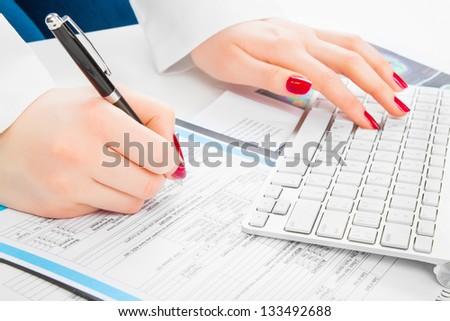 Doctor writing prescription. Selective focus - stock photo