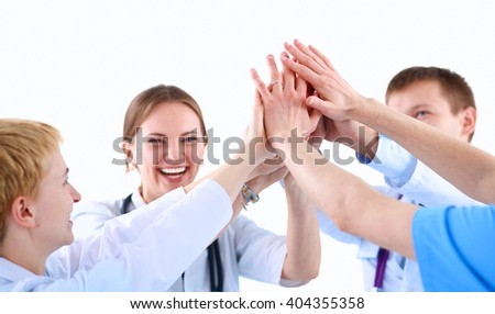 Doctors and nurses in a medical team stacking hands  - stock photo