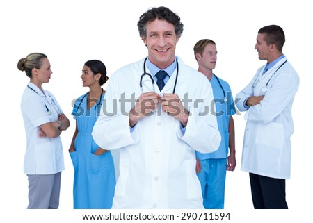 Doctors and nurses standing together on a white background