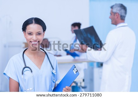 Doctors and patient with x-ray in the hospital - stock photo