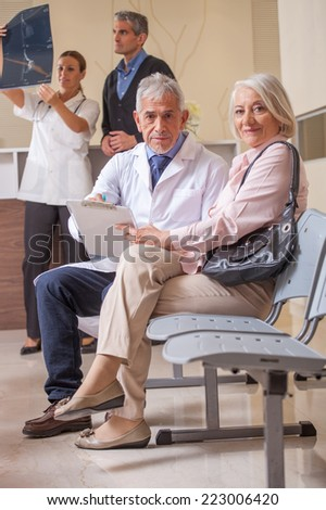 Doctors and patients discussing medical exams results. - stock photo