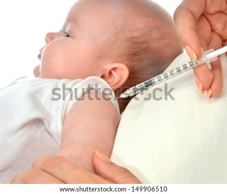 Doctors hand with syringe vaccinating child baby flu injection shot isolated on a white background - stock photo