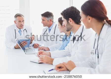Doctors having a medical discussion in a meeting room - stock photo