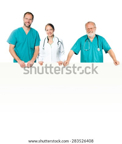 doctors in a green and white uniform with a white banner - stock photo