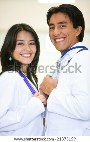 doctors in a hospital smiling and looking friendly