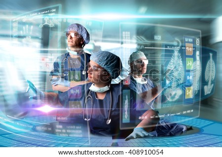 Doctors in a research station with digital  screens and keyboard - stock photo