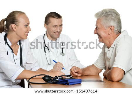 Doctors talking with old man