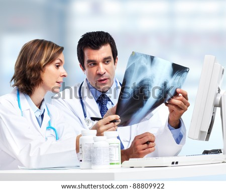 Doctors team with x-ray. Health care. Radiology. - stock photo