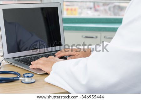 Doctors using laptop at work