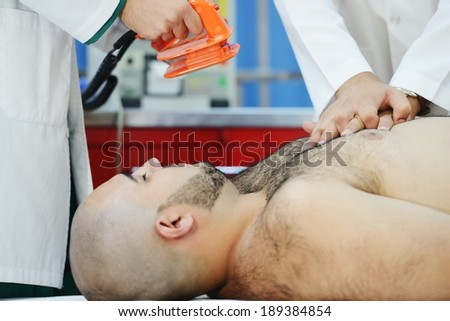 Doctors working at modern hospital for heart attack - stock photo